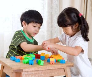 Two children playing blocks